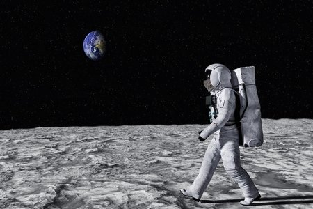 Astronaut walking across moon