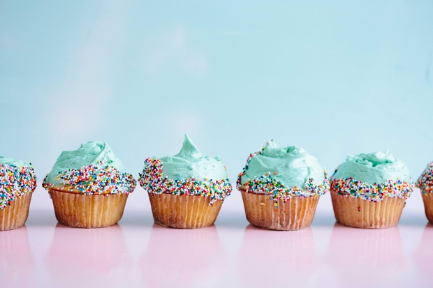 row of blue cupcakes