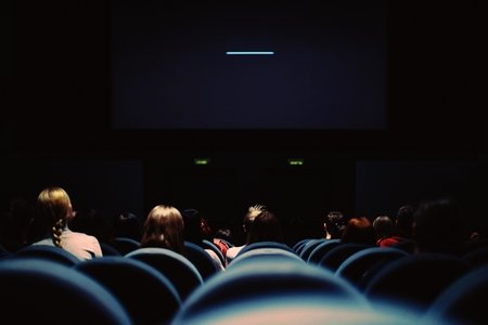 a movie theater with the projector on