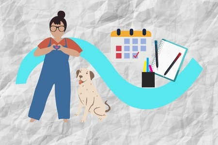 girl and her dog with a calendar, planner, and pens