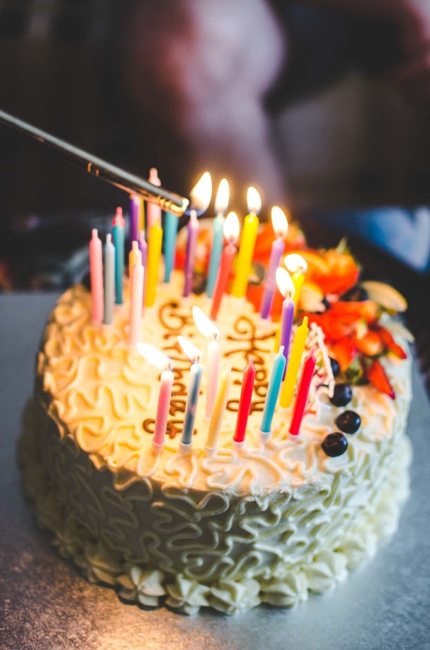 Candles being lit on birthday cake