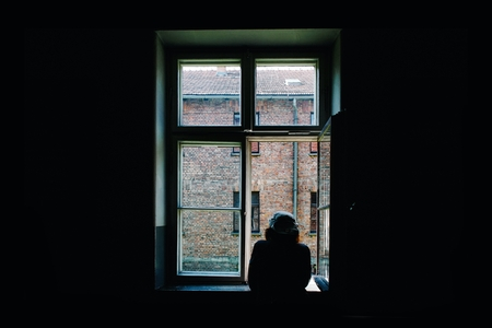 person looking out window