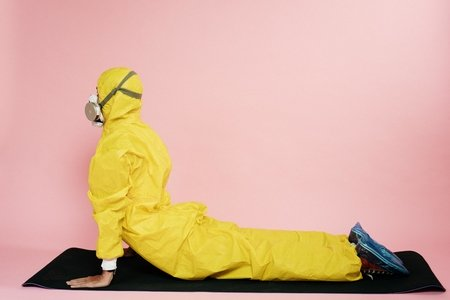 man in yellow suit stretching