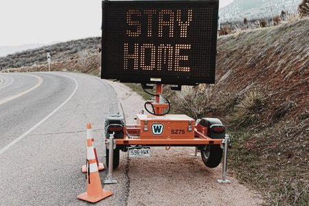 "road sign that says ""stay home"""