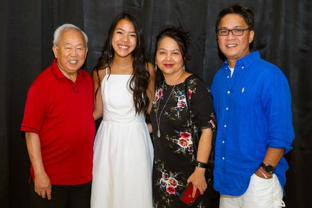 Adriana with parents and grandpa