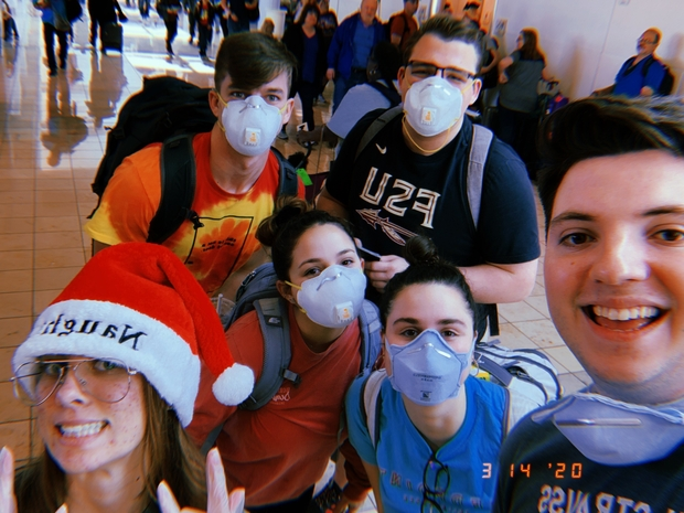 My friends and I in masks at the airport