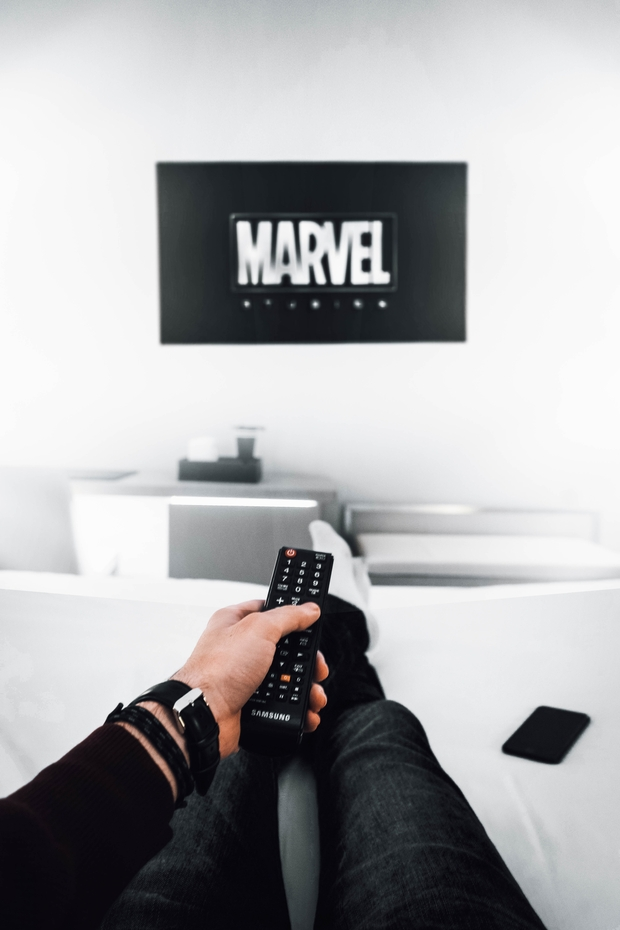 person watching Marvel on TV