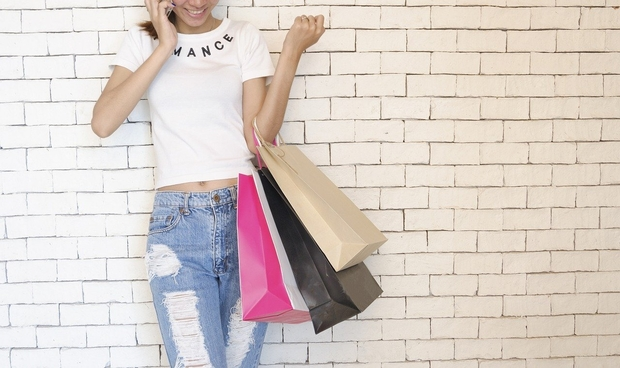 Girl on the phone with shopping bags