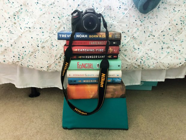 Camera on top of a stack of books