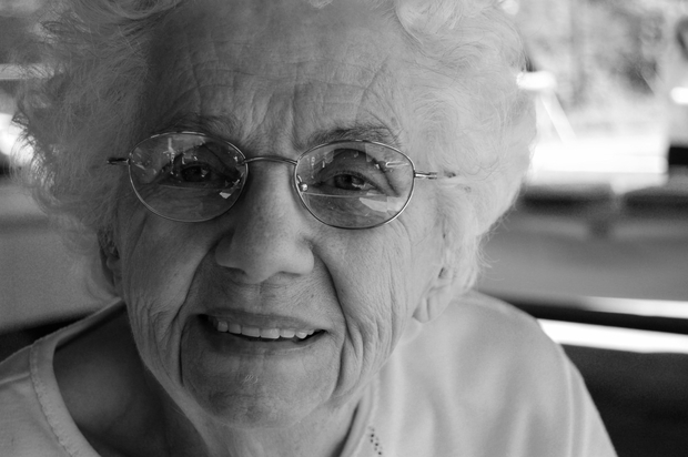 old woman with glasses smiling