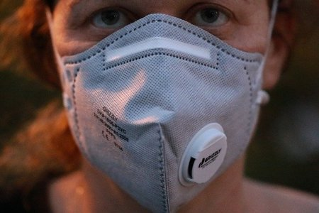Women wearing a mask for health purpose