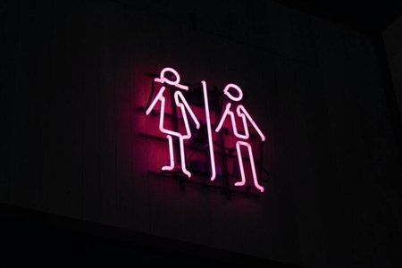 neon sign of male and female stick figures