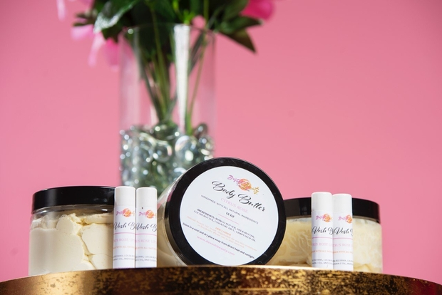 DeVosh Beauty products with a vase of flowers in the background