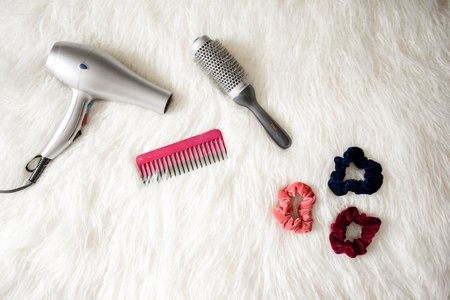 blow dryer, comb, scrunchie