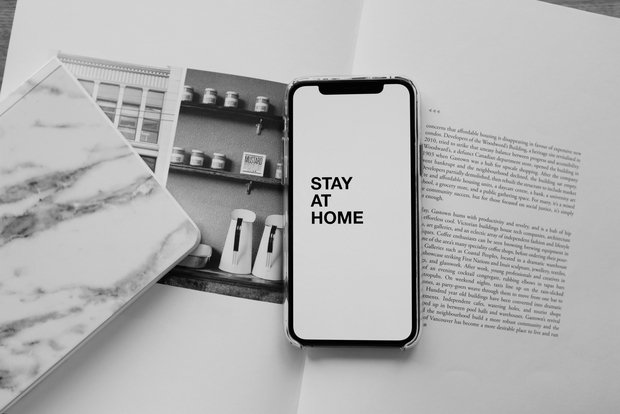 phone screen that says stay at home