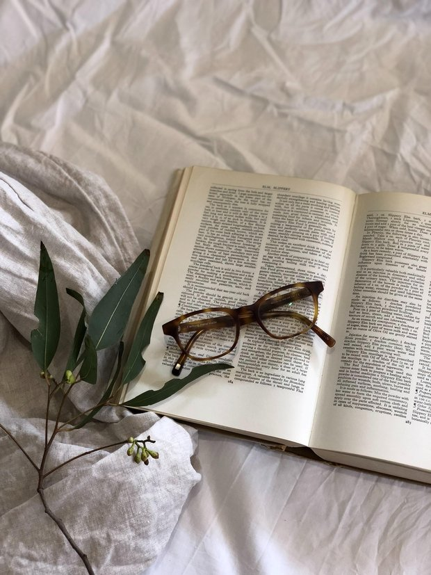 book in bed with glasses