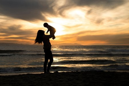 sunset with mom and baby in background