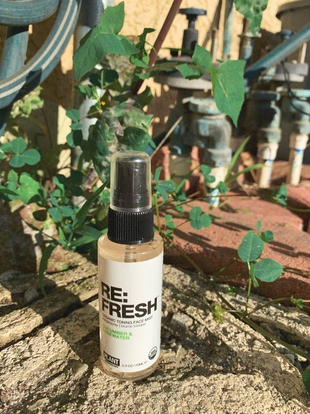 facial toner in front of leaves
