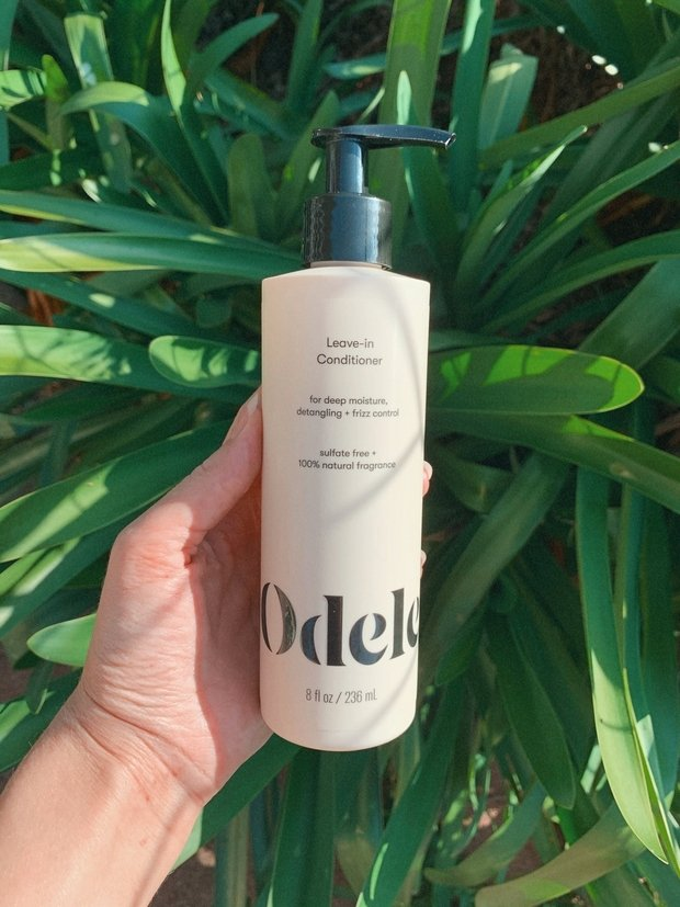 leave in conditioner in front of a bush