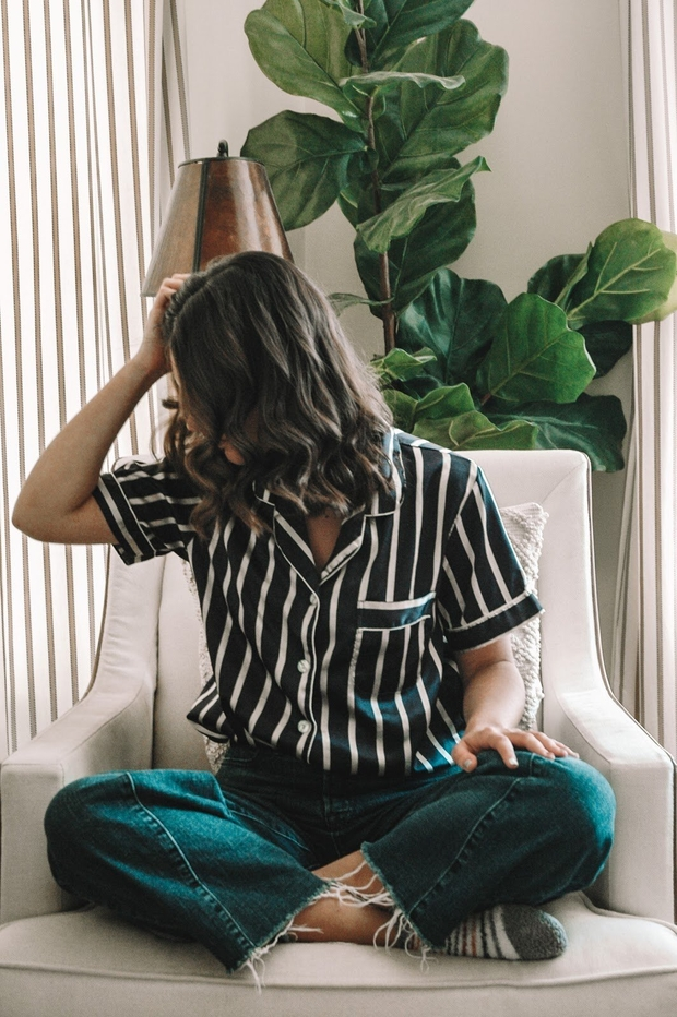 izzy in chair with shirt