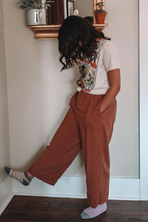 izzy woman wearing pants