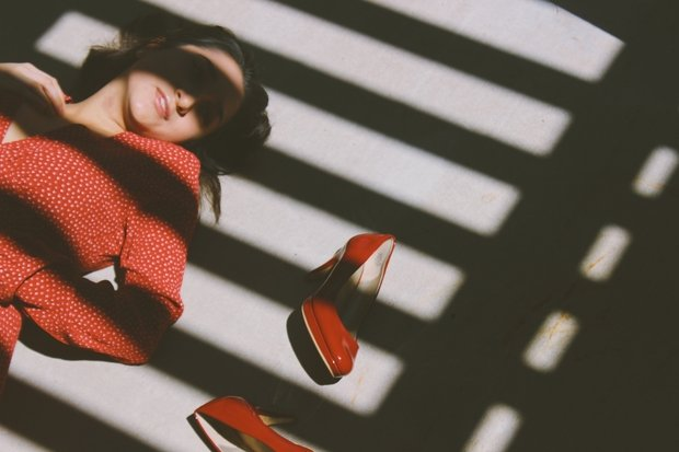 girl in red with shadows and heels