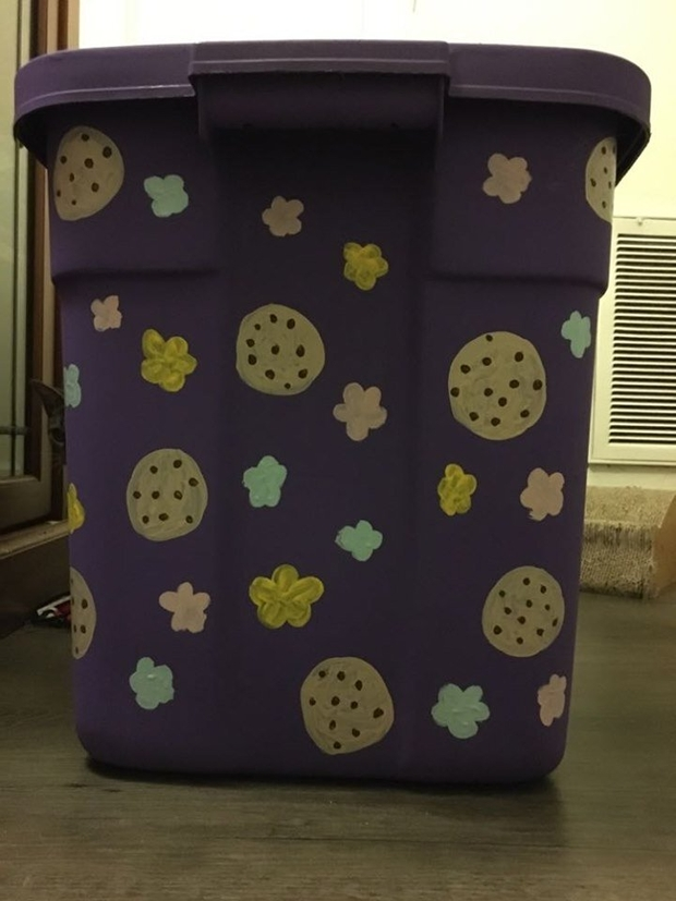 painted side of a storage container with flowers and cookies