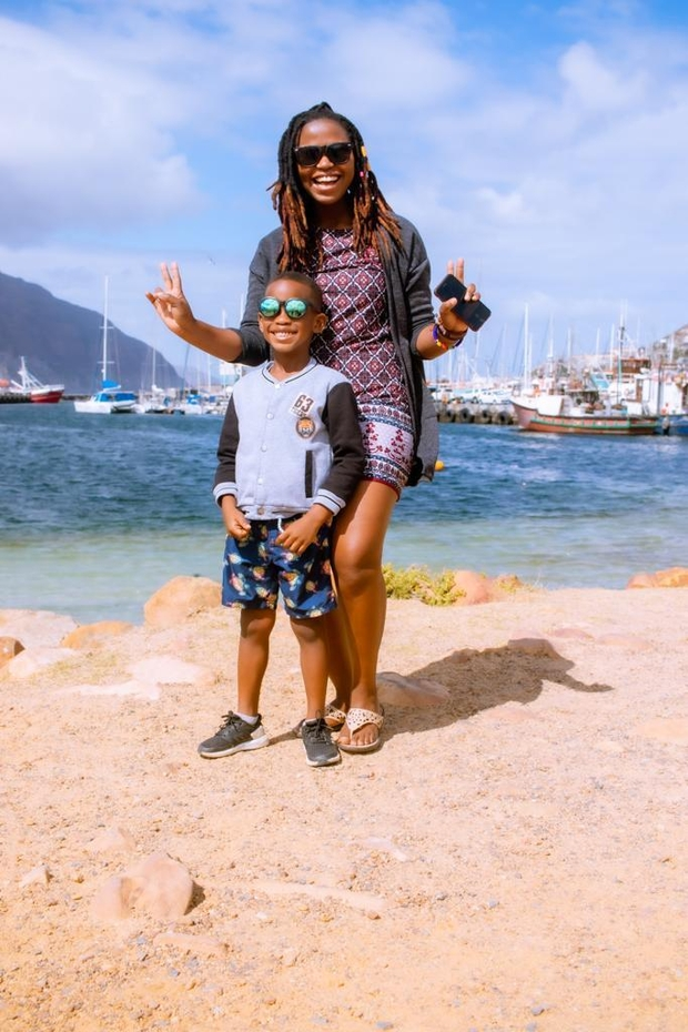 Jill Chidisha Samukimba at the harbour with her son.