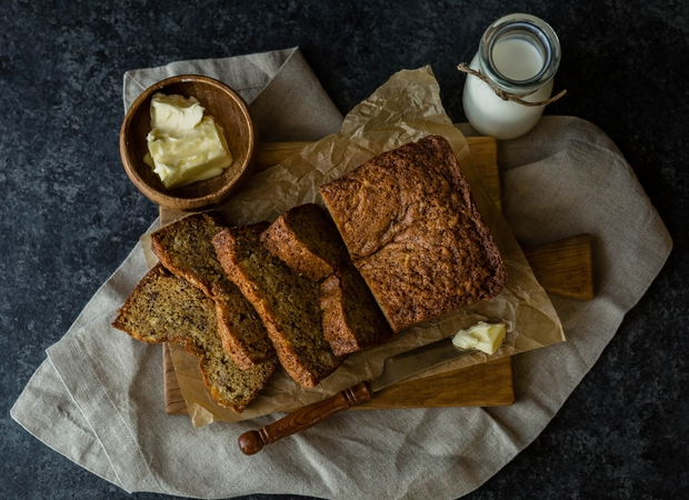 banana bread next to butter and milk