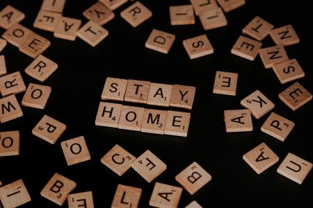 """scrabble pieces spelling out """"stay home"""""""