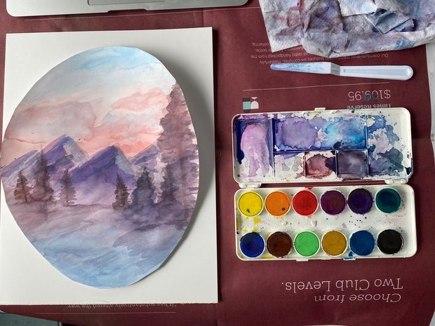 a painting and paint on a table