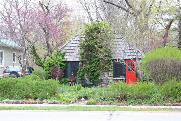 small cottage with red door in Iowa City