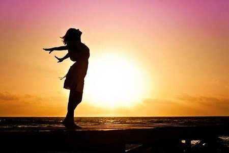 woman at the beach in the sunrise