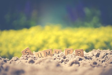 Summer spelled out on soil