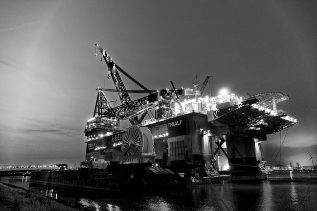 black and white photo of an oil rig