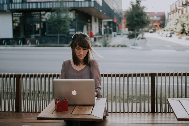 woman outside with laptop