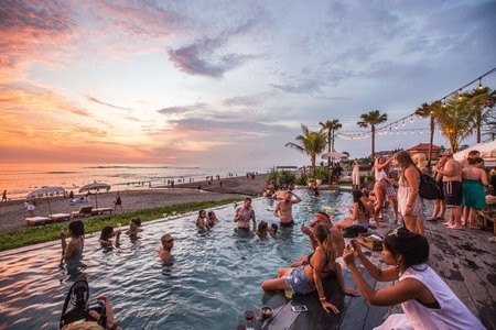pool party by the water at sunset in summer