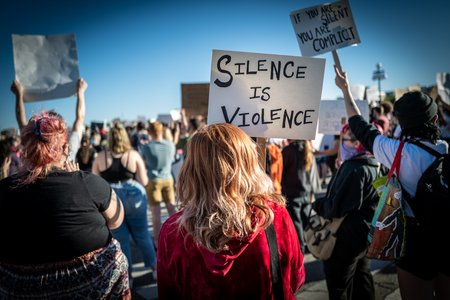silence is violence protest sign