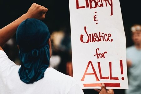 liberty and justice for all protest sign