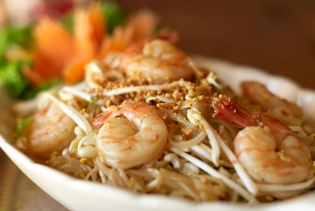 up close photo of a plate of pad thai with shrimp