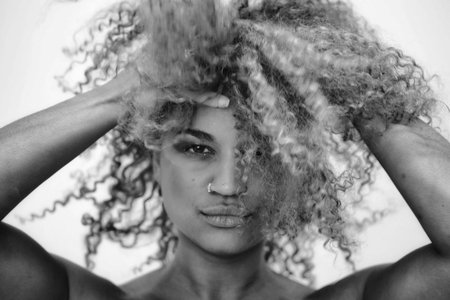 Woman with curly hair- black and white photo