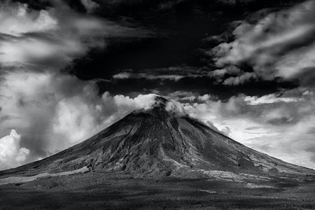 Black and white photo of active volcano eruption