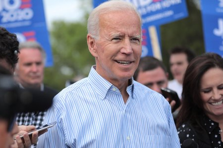 Joe Biden smiling at outdoor event