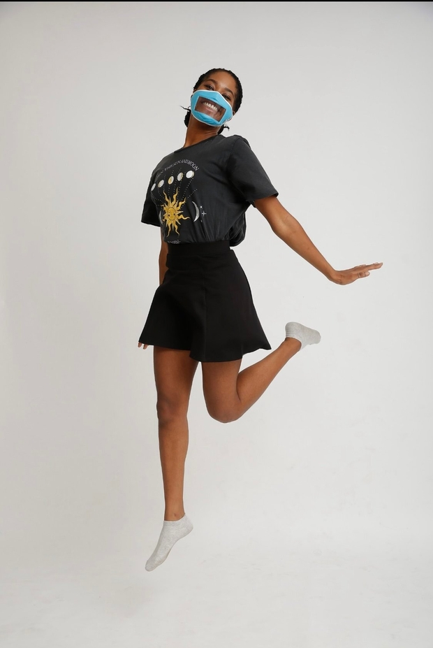 Girl jumping with smile mask