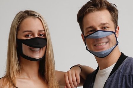 Boy and girl with smile mask
