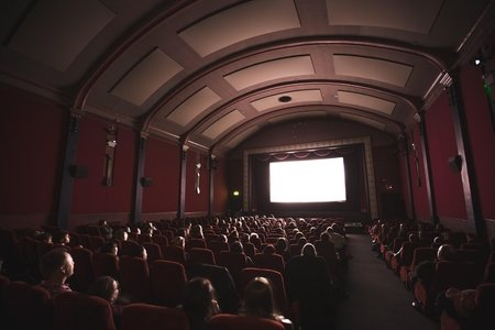 group of people looking at a movie theatre screen