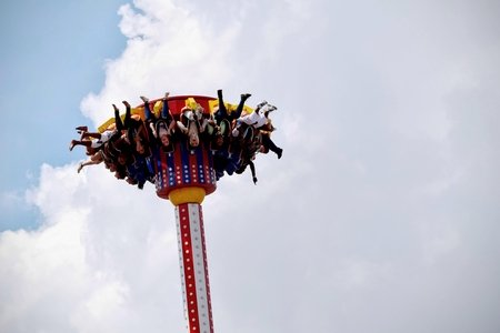 people riding on amusement park