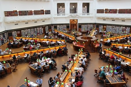 top down view of library with people sitting at desks