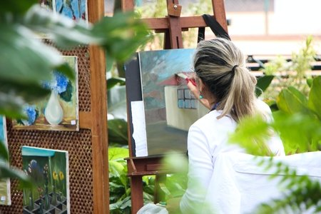 Woman Painting Outside Garden