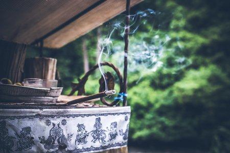 An incense burning in a garden.